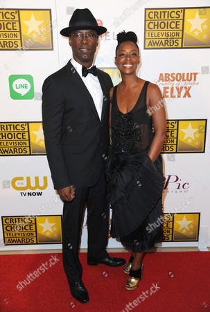 Isaiah Washington, left, and Jenisa Garland arrive at the Critics' Choice Television Awards at the Beverly Hilton Hotel, in Beverly Hills, Calif
