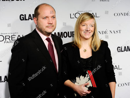 Designer Sarah Burton and husband David Burton attend the 2014 Glamour Women of the Year Awards at Carnegie Hall, in New York