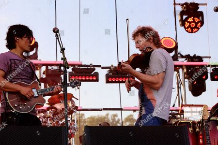 Michael Kang (L) and the String Cheese Incident with special guest Sam Bush (R) performs at the 2014 Lock'n Festival, in Arrington, Virginia