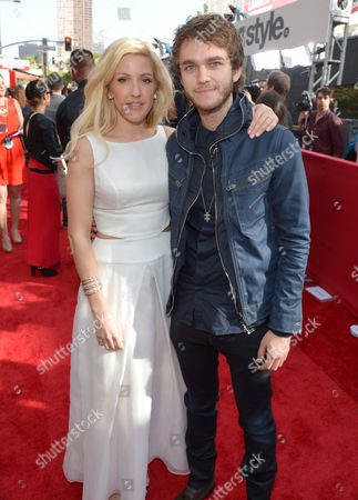 Ellie Goulding, left, and Zedd arrive at the 2014 MTV Movie Awards, on in Los Angeles