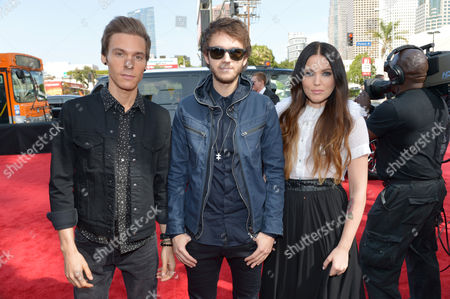 From left, Matthew Koma, Zedd and Miriam Bryant arrive at the 2014 MTV Movie Awards, on in Los Angeles