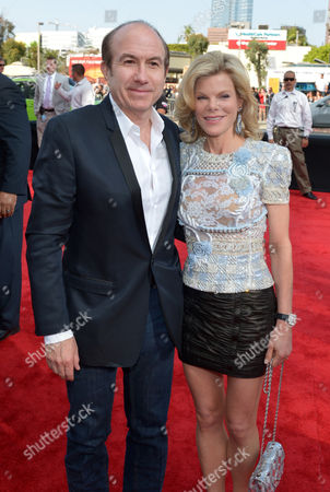 Philippe Dauman, president and CEO of Viacom Inc., left, and Deborah Dauman arrive at the 2014 MTV Movie Awards, on in Los Angeles