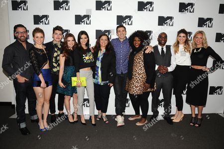 "Stock Image of IMAGE DISTRIBUTED FOR MTV - From left, MTV's ""Faking It"" Show runner Carter Covington, Rita Volk, Gregg Sulkin, Katie Stevens, Victoria Justice, President of Programming for MTV Susanne Daniels, Andrew Schulz, Nicole Byer, Charlamagne, Molly Tarlov, and Barret Swatek seen at the 2014 MTV Upfront Press Junket at the Beacon Hotel Lower Level on in New York"