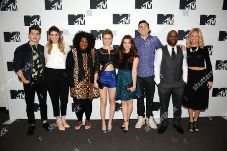 Stock Picture of From left, Gregg Sulkin, Molly Tarlov, Nicole Byer, Rita Volk, Katie Stevens, Andrew Schulz, Charlamagne, and Barret Swatek seen at the 2014 MTV Upfront Press Junket at the Beacon Hotel Lower Level on in New York