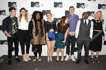 IMAGE DISTRIBUTED FOR MTV - From left, Gregg Sulkin, Molly Tarlov, Nicole Byer, Rita Volk, Katie Stevens, Andrew Schulz, Charlamagne, and Barret Swatek seen at the 2014 MTV Upfront Press Junket at the Beacon Hotel Lower Level on in New York, New York