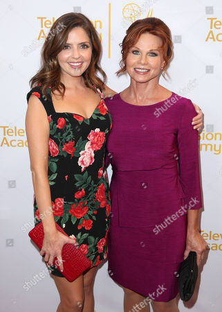 Jen Lilley, left, and Patsy Pease arrive at the Television Academy's 66th Emmy Awards Performers Peer Group Celebration at the Montage Beverly Hills, in Beverly Hills, Calif