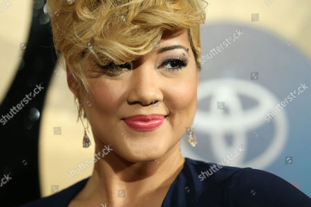 Singer Tessanne Chin arrives during the 2014 Soul Train Awards at the Orleans Arena at The Orleans Hotel & Casino on in Las Vegas, NV