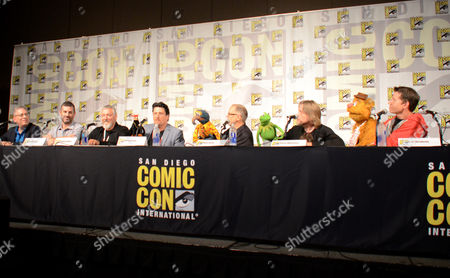 "Bill Prady, from left, Bob Kushell, Randall Einhorn, Bill Barretta, Dave Goelz, Steve Whitmire, and Eric Jacobson attend ""The Muppets"" panel on day 3 of Comic-Con International, in San Diego"