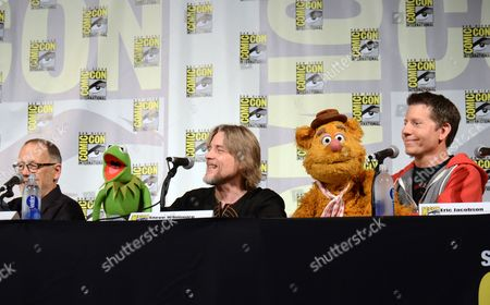 "Dave Goelz, from left, Kermit the Frog, puppeteer Steve Whitmire, Fozzie the Bear, and puppeteer Eric Jacobson attend ""The Muppets"" panel on day 3 of Comic-Con International, in San Diego"