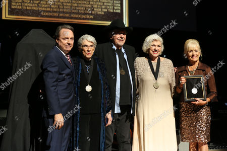 From left, Jody Williams, Maxine Brown, Bobby Bare, Bonnie Brown and Becky Brown stand onstage at The Country Music Hall of Fame 2015 Meseen at The Country Music Hall of Fame 2015 Medallion Ceremony at Country Music Hall of Fame and Museum on in Nashville, Tenn