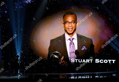 Stock Photo of Nate Ruess performs an In Memoriam tribute at the ESPY Awards at the Microsoft Theater, in Los Angeles. Pictured onscreen is Stuart Scott