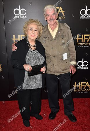 Doris Roberts, left, and Jack Betts arrive at the Hollywood Film Awards at the Beverly Hilton Hotel, in Beverly Hills, Calif