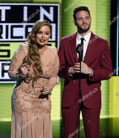 Chiquis Rivera, left, and Gabriel Coronel speak onstage at the Latin American Music Awards at the Dolby Theatre, in Los Angeles