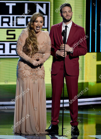 Chiquis Rivera, left, and Gabriel Coronel speak at the Latin American Music Awards at the Dolby Theatre, in Los Angeles