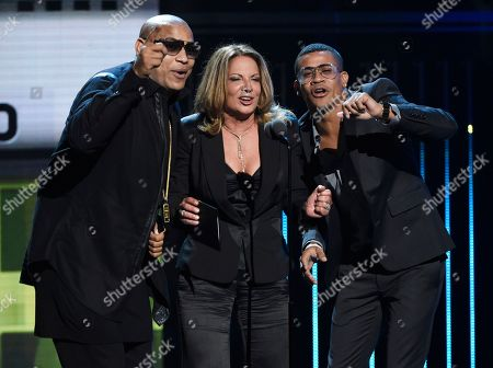 Alexander Delgado, from left, Ana Maria Polo, and Randy Malcom Martinez present the award for favorite male artist - urban at the Latin American Music Awards at the Dolby Theatre, in Los Angeles