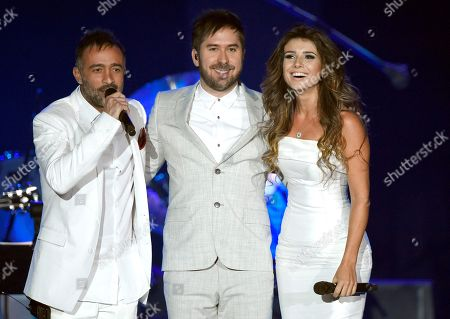 "Mario Domm, left, and Pablo Hurtado, center, of Camila, and Paula Fernandes perform ""Propuesta"" at the Latin Recording Academy Person of the Year Tribute honoring Roberto Carlos at the Mandalay Bay Convention Center, in Las Vegas"