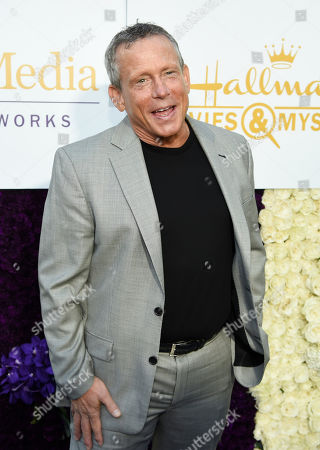 Actor Willie Aames poses at the Crown Media Family Networks Television Critics Association party, in Beverly Hills, Calif