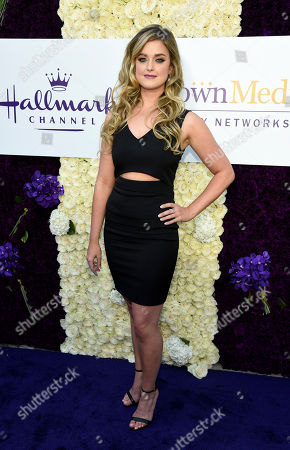 Actress Ashley Newbrough poses at the Crown Media Family Networks Television Critics Association party, in Beverly Hills, Calif