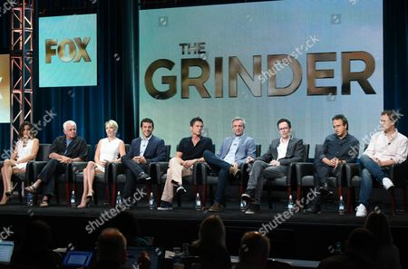 Natalie Morales, from left, William Devane, Mary Elizabeth Ellis, Fred Savage, Rob Lowe, creators/executive producers Andrew Mogel and Jarrad Paul, executive producer/director Jake Kasdan and executive producer Greg Malins participate in 'The Grinder' panel at the Fox Television Critics Association Summer Tour at the Beverly Hilton Hotel, in Beverly Hills, Calif