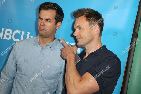 Michael Kosta, left, and Joel McHale arrive at the NBCUniversal Television Critics Association Summer Tour at the Beverly Hilton Hotel, in Beverly Hills, Calif