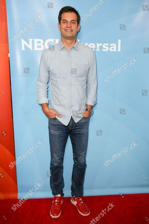 Michael Kosta arrives at the NBCUniversal Television Critics Association Summer Tour at the Beverly Hilton Hotel, in Beverly Hills, Calif