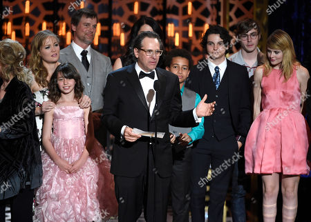 """Jason Katims and the cast of """"Parenthood"""" accept the fan favorite award at the TV Land Awards at the Saban Theatre, in Beverly Hills, Calif"""