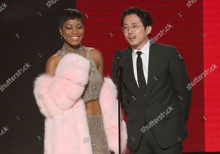 Keke Palmer, left, and Steven Yuen present the award for favorite artist - rap/hip-hop at the American Music Awards at the Microsoft Theater, in Los Angeles