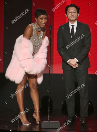 Stock Image of Keke Palmer, left, and Steven Yuen present the award for favorite artist - rap/hip-hop at the American Music Awards at the Microsoft Theater, in Los Angeles