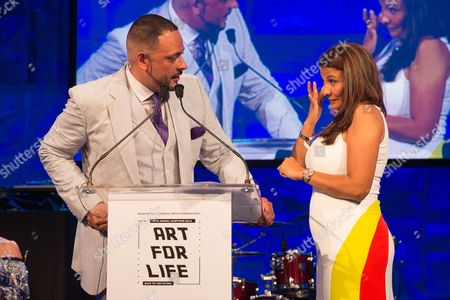 James Cruz, left, speaks on stage at the 2016 Art For Life Benefit, presented by Russell Simmons' RUSH Philanthropic Arts Foundation, at Fairview Farms,, in Water Mill, New York