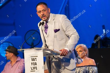 Stock Image of James Cruz speaks on stage at the 2016 Art For Life Benefit, presented by Russell Simmons' RUSH Philanthropic Arts Foundation, at Fairview Farms,, in Water Mill, New York