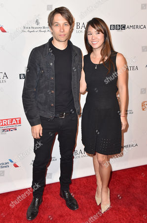 Sean Baker, left, and Samantha Quan arrive at the BAFTA Awards Season Tea Party at the Four Seasons Hotel, in Los Angeles