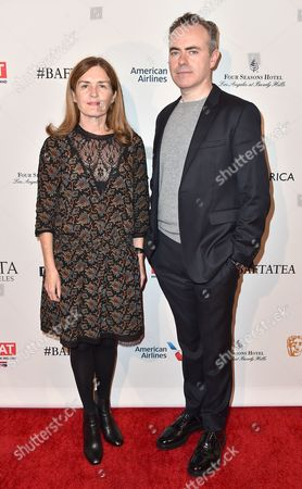 Finola Dwyer, left, and John Crowley arrive at the BAFTA Awards Season Tea Party at the Four Seasons Hotel, in Los Angeles