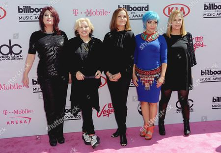 Abby Travis, from left, Gina Schock, Belinda Carlisle, Jane Wiedlin and Charlotte Caffey, of The Go Go's, arrive at the Billboard Music Awards at the T-Mobile Arena, in Las Vegas