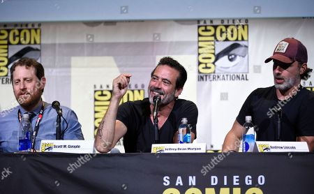 """Scott M. Gimple, from left, Jeffrey Dean Morgan, and Andrew Lincoln attend """"The Walking Dead"""" panel on day 2 of Comic-Con International, in San Diego"""