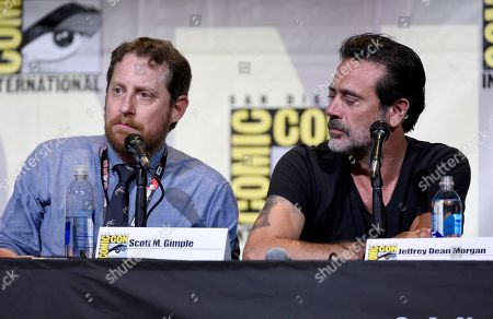 """Scott M. Gimple, left, and Jeffrey Dean Morgan attend """"The Walking Dead"""" panel on day 2 of Comic-Con International, in San Diego"""