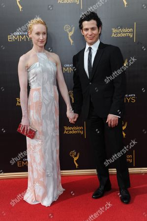 Angela Christian, left, and Thomas Kail arrive at night two of the Creative Arts Emmy Awards at the Microsoft Theater, in Los Angeles