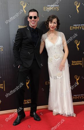 Rich Blomquist, left, and Kristen Schaal arrive at night two of the Creative Arts Emmy Awards at the Microsoft Theater, in Los Angeles