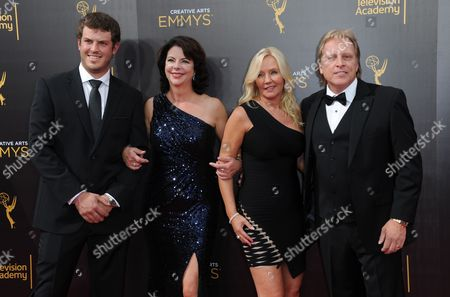 Sean Dwyer, from left, guest, June Hansen, and Sig Hansen arrive at night two of the Creative Arts Emmy Awards at the Microsoft Theater, in Los Angeles