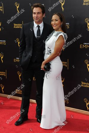 Stock Image of Robb Derringer, left, and Carrie Ann Inaba arrive at night two of the Creative Arts Emmy Awards at the Microsoft Theater, in Los Angeles