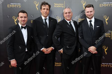 Dane Lillegard, from left, Brian McGinn, Andrew Fried and David Gelb arrives at night two of the Creative Arts Emmy Awards at the Microsoft Theater, in Los Angeles