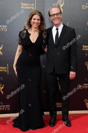 Amy Ziering, left, and Kirby Dick arrive at night two of the Creative Arts Emmy Awards at the Microsoft Theater, in Los Angeles