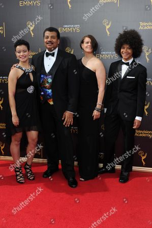 Miranda Tyson, from left, Neil deGrasse Tyson, Alice Young, and Travis Tyson arrives at night two of the Creative Arts Emmy Awards at the Microsoft Theater, in Los Angeles
