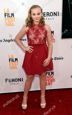 """Madison Wolfe, a cast member in """"The Conjuring 2,"""" poses at the premiere of the film during the Los Angeles Film Festival at the TCL Chinese Theatre, in Los Angeles"""