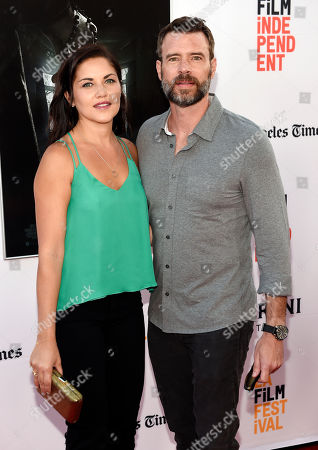 """Actor Scott Foley and his wife Marika Dominczyk pose together at the premiere of the film """"The Conjuring 2"""" during the Los Angeles Film Festival at the TCL Chinese Theatre, in Los Angeles"""