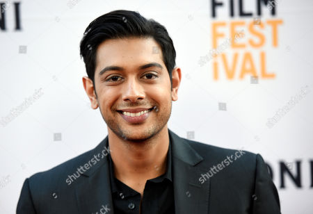 """Abhi Sinha, a cast member in """"The Conjuring 2,"""" poses at the premiere of the film during the Los Angeles Film Festival at the TCL Chinese Theatre, in Los Angeles"""