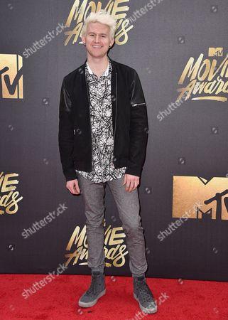 Ricky Dillon arrives at the MTV Movie Awards at Warner Bros. Studios, in Burbank, Calif
