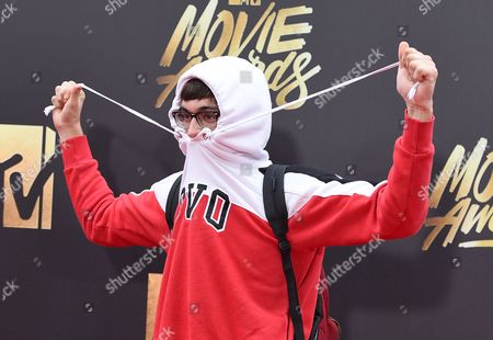 Brandon Wardell arrives at the MTV Movie Awards at Warner Bros. Studios, in Burbank, Calif