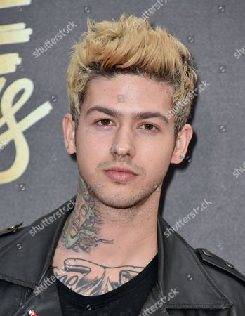 T. Mills arrives at the MTV Movie Awards at Warner Bros. Studios, in Burbank, Calif