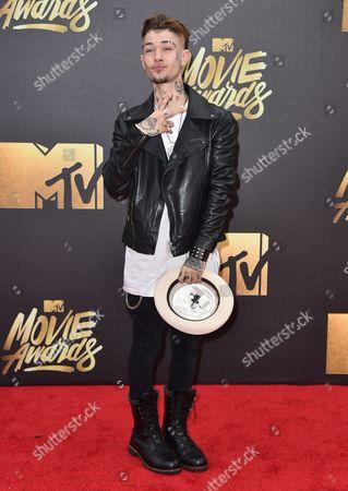 Stock Image of Liam Horne arrives at the MTV Movie Awards at Warner Bros. Studios, in Burbank, Calif