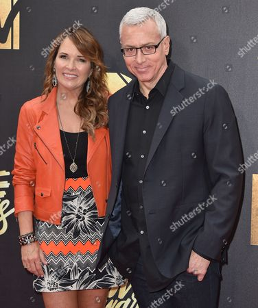 Susan Pinsky, left, and Drew Pinsky arrive at the MTV Movie Awards at Warner Bros. Studios, in Burbank, Calif